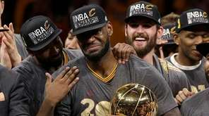 Cleveland Cavaliers forward LeBron James, center, celebrates with