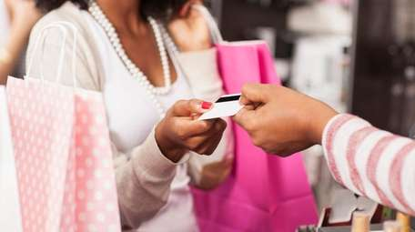 Store-branded cards are charging record-high interest rates, on