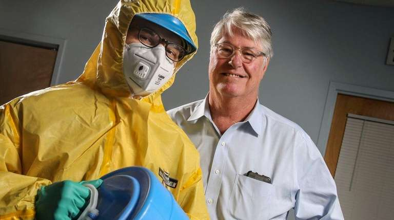 Lakeland Industries CEO Christopher Ryan, right, shows some