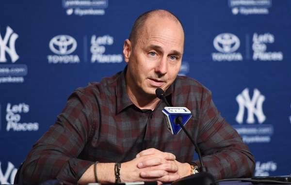 Yankees general manager Brian Cashman answers questions from