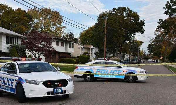 Suffolk County police cars block traffic on Old