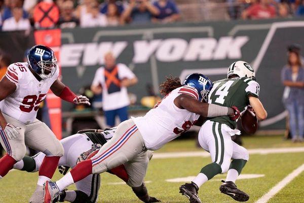 Damon Harrison of the Giants sacks Jets' quarterback