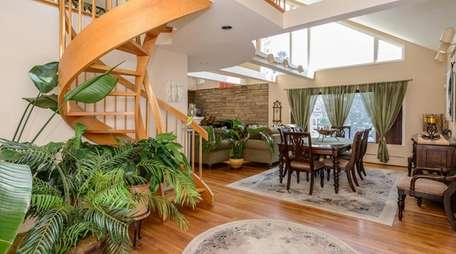 The spiral staircase in this Massapequa house leads