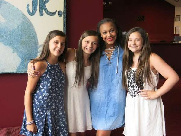 Nia Sioux, center, with Kidsday reporters, from left,