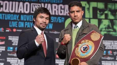 Boxers Manny Pacquiao, left, and Jessie Vargas pose