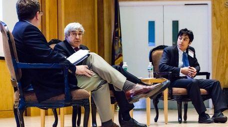 Henry Schein CEO Stanley Bergman, center, and his