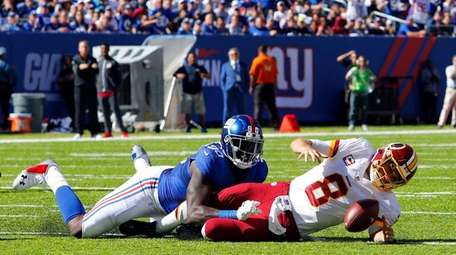 The Giants' Jason Pierre-Paul sacks the Redskins' Kirk