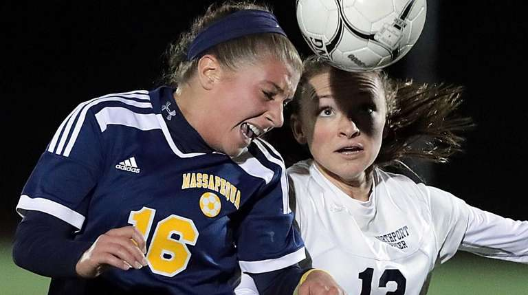 Massapequa's Jaime Cristallo (16) wins the header in