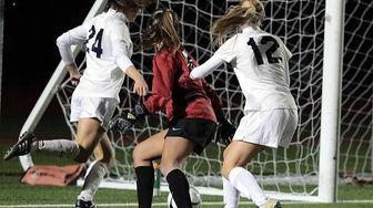 Northport's Juliana Conforti (24) kicks the loose ball