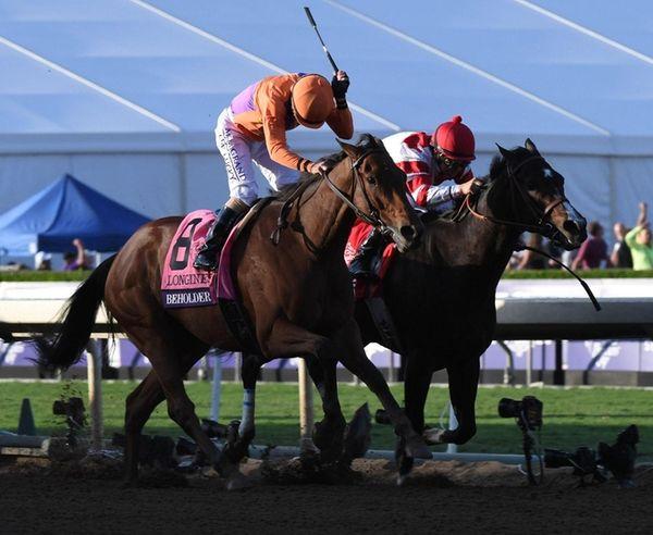 Beholder, left, ridden by jockey Gary Stevens, wins