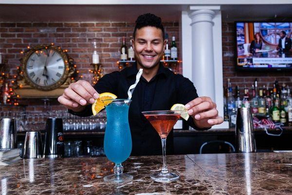 Brendon Ernst, 24, of Brentwood, bartender, add garnishes