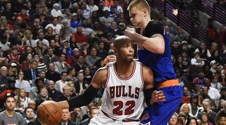 Chicago Bulls' forward Taj Gibson (22) dribbles as