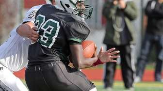 Elmont's Joshua Milfort St. Cyr spins as he's