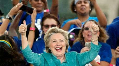 Democratic presidential candidate Hillary Clinton gives supporters a