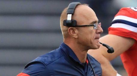 Stony Brook head coach Chuck Priore looks on