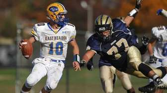 Anthony LaRosa #10, East Meadow quarterback, left, scrambles