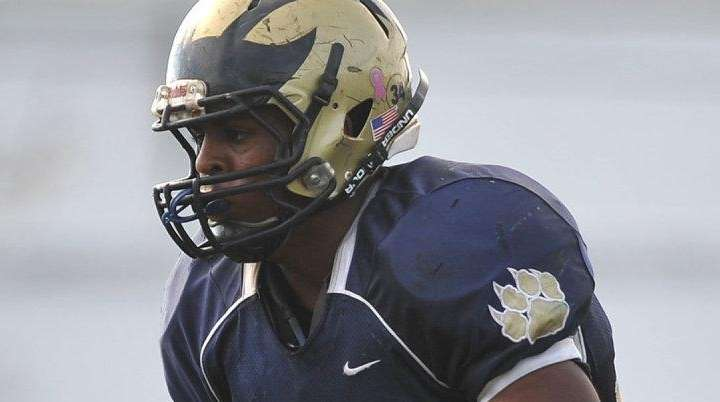 Johnathan Debique #34 of Baldwin rushes into the