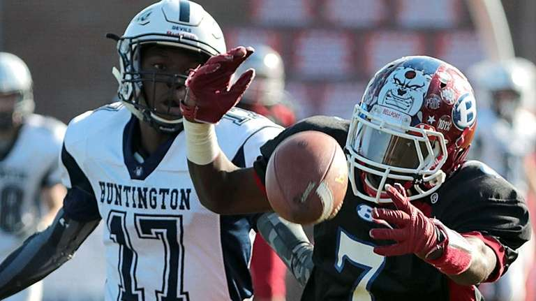 The pass to Bellport's Justin Roundtree (7) is