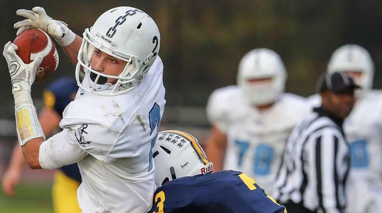 Michael DeDonato of Massapequa makes the tackle on