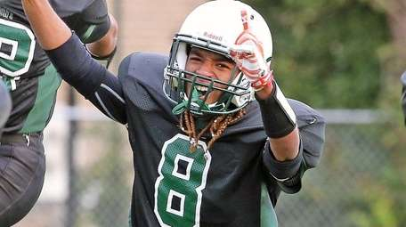 Elmont's Sevin Malcolm reacts to their victory against