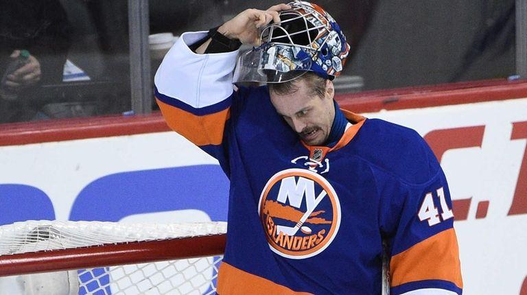 New York Islanders' goalie Jaroslav Halak stands in