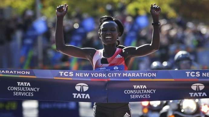 Mary Keitany of Kenya crosses the finish line
