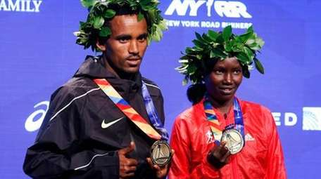 Men's race winner Ghirmay Ghebreslassie, of Eritrea, and