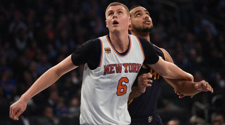 New York Knicks forward Kristaps Porzingis boxes out