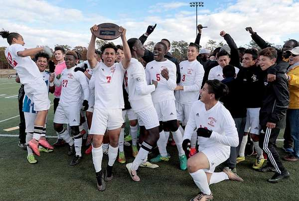 Amityville's boys soccer team holds up the championship