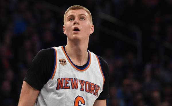 New York Knicks forward Kristaps Porzingis watches a