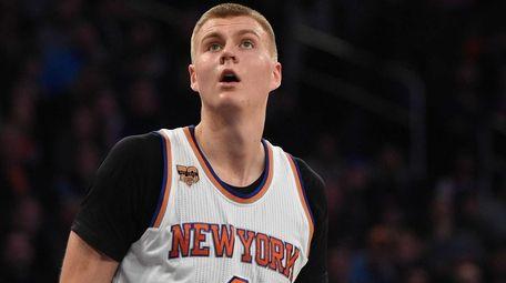 New York Knicks forward Kristaps Porzingis watches a