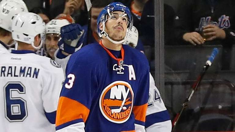 New York Islanders defenseman Travis Hamonic reacts after