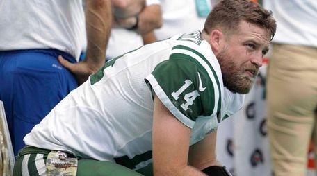 New York Jets quarterback Ryan Fitzpatrick sits on