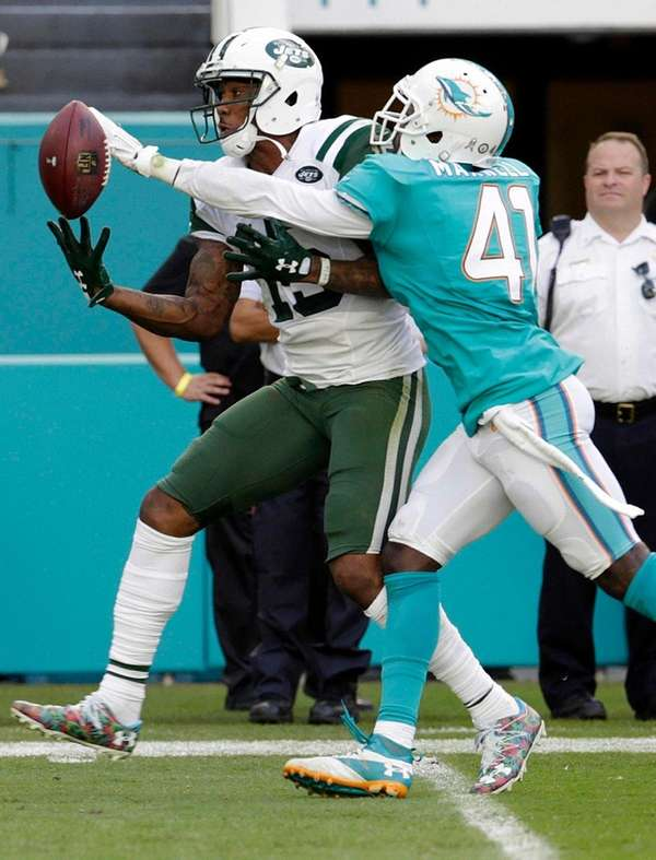 Miami Dolphins cornerback Byron Maxwell attempts to block