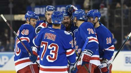 New York Rangers players celebrate a goal by