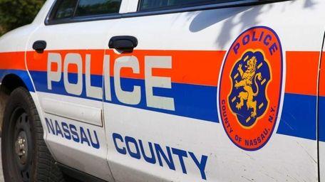 A Nassau County police car sits outside of