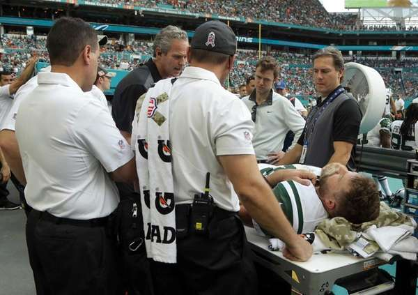 New York Jets quarterback Ryan Fitzpatrick is checked