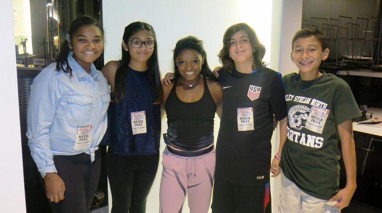 Simone Biles, center, at the 2016 Kellogg's Tour