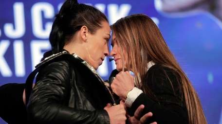 Strawweight champion Joanna Jedrzejczyk, left, faces off with