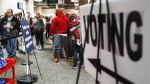 A line of early voters wait in queue