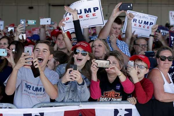Supporters cheer for Donald Trump during a campaign