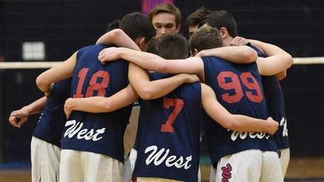 Smithtown West players huddle against Northport before a