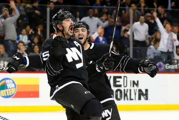 Cal Clutterbuck, left, celebrates with Alan Quine after