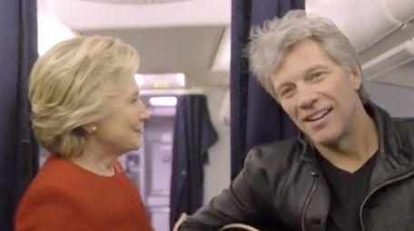 Hillary Clinton, center, and Jon Bon Jovi, right,