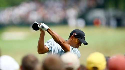 Tiger Woods plays his tee shot on the
