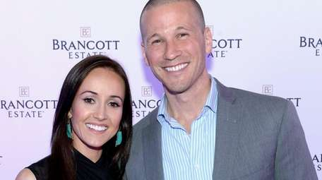 Ashley Hebert and J.P. Rosenbaum attend an event