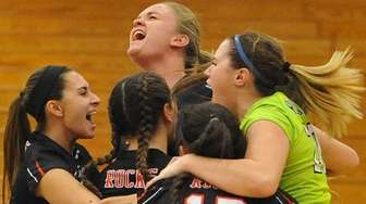 East Rockaway girls volleyball players celebrate after their