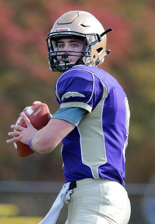 Sayville quarterback Jack Coan (9) warms up before