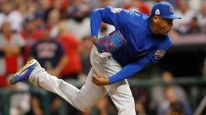 Chicago Cubs pitcher Aroldis Chapman throws in the