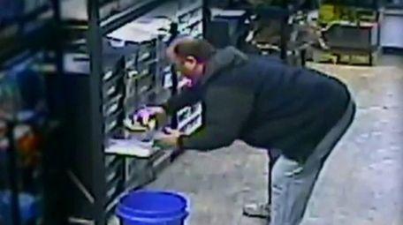 Repxotica surveillance cameras show a man removing a